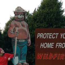 Claire Belcher (with Smokey Bear) wildFIRE Lab